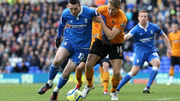 Birmingham City's Jordon Mutch (left) and Wolverhampton Wanderers' Christophe Berra battle for the ball during the FA Cup, Third Round match at St Andrews, Birmingham. Photo: Nick Potts/PA Wire