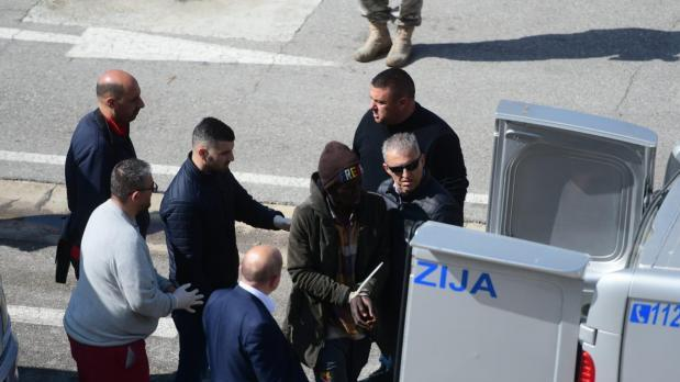 A man being taken away in handcuffs after the boat was stormed. File photo.