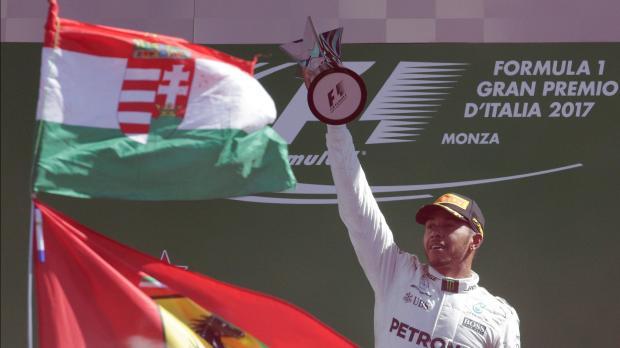 Mercedes' Lewis Hamilton celebrates winning the race.