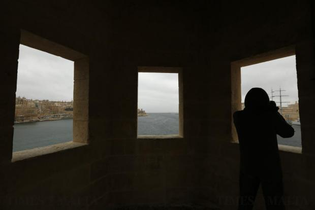 A tourist takes a picture of Grand Harbour from the gardjola (watch tower) on the newly restored Senglea bastions on February 17. Photo: Darrin Zammit Lupi