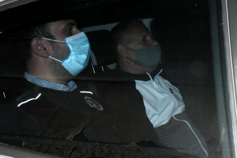 George Degiorgio (right) being driven out of court on Wednesday night. Photo: Chris Sant Fournier