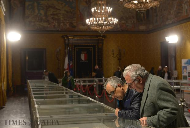 Two gentlemen view replicas of letters from the Vatican Secret Archives exhibited at the President's Palace in Valletta on March 28. Photo: Matthew Mirabelli