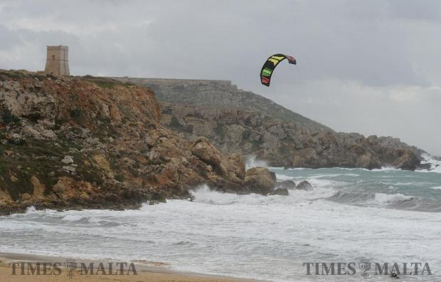 As strong Westerly winds hit the island a kite surfer takes to the water at Golden Bay on January 5. Photo: Matthew Mirabelli