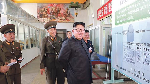 North Korean leader Kim Jong-Un smiles during a visit to the Chemical Material Institute of the Academy of Defence Sciences. Photo: Reuters