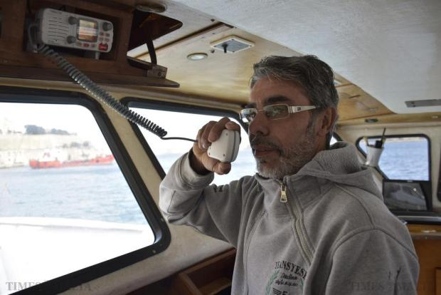 Angelo Miraglia, captain of the detained fishing vessel Mariella, contacts Valletta Port Control from the boat's bridge in Grand Harbour on December 17. The seven foreign fishermen on the boat, though not formally under arrest, said they were not being allowed to leave the island. Photo: Mark Zammit Cordina