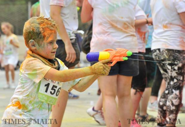A young boy sprays a water pistol during the Colour my Run event in Ta' Qali on June 12. Photo: Steve Zammit Lupi