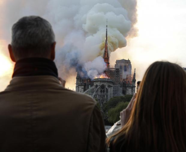 The historic building goes up in flames.