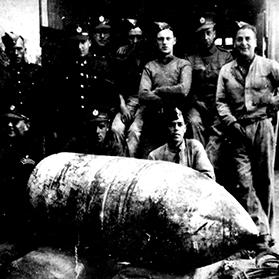 Members of the bomb disposal unit with the 500kg bomb that penetrated the dome on April 9, 1942, but failed to explode. Photo from the collection of Maria Vella