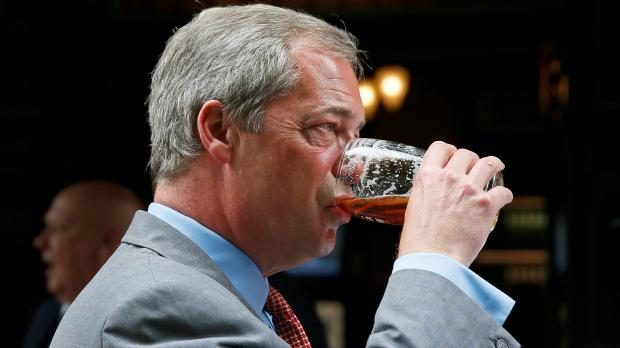 eader of the United Kingdom Independence Party Farage enjoys a pint of beer in central London.