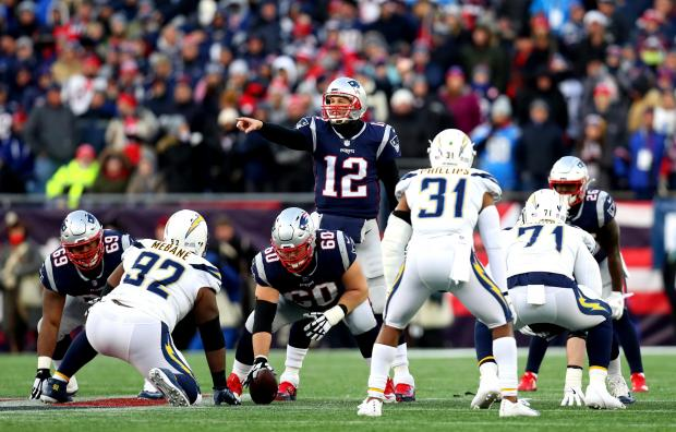 Tom Brady #12 of the New England Patriots reacts at the line of scrimmage.