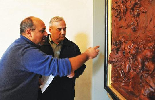 Italian restorer Giuseppe Mantella (left) and Fr Edgar Vella discussing a detail from the Adoration by the Shepherds.