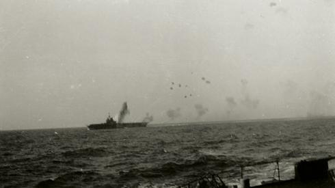 HMS Illustrious under attack in the central Mediterranean.