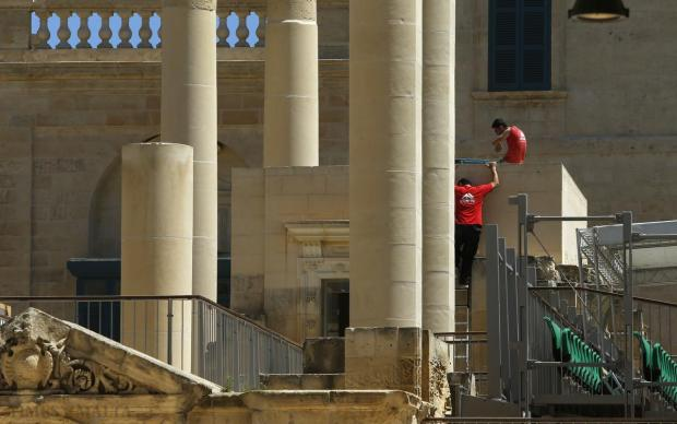 Technicians carry out works at Pjazza Teatru Rjal in Valletta on May 12. Photo: Darrin Zammit Lupi