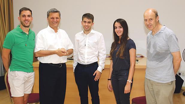 Gozo Bishop Mario Grech and Fr Effie Masini with the three youths from the Don Bosco Oratory. Photos: Charles Spiteri