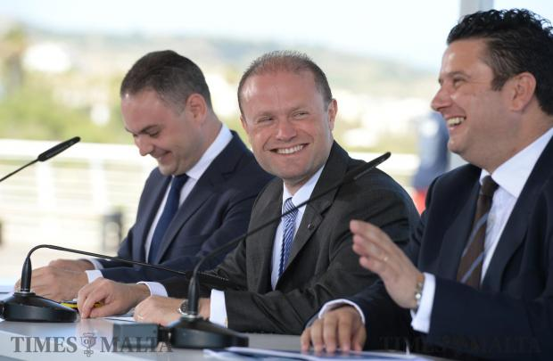 Prime Minister Joseph Muscat shares a laugh with Tourism Minister Edward Zammit Lewis at a press conference in Qawra on May 19. Photo: Matthew Mirabelli