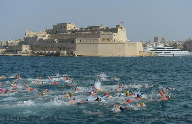 Swimmers take part in the B'kara St Joseph 2km swim around the Grand harbour on June 7. Photo: Matthew Mirabelli