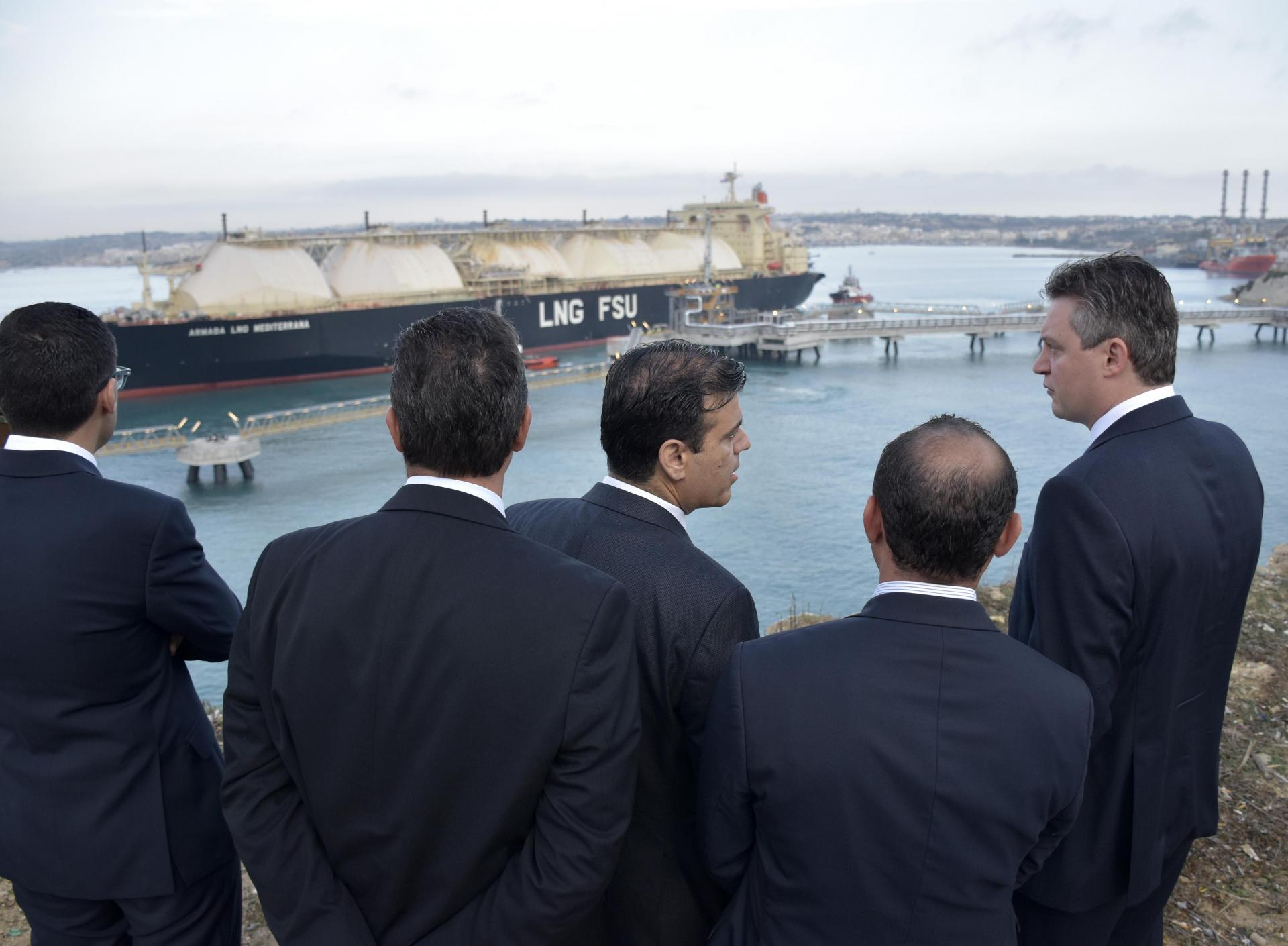 Konrad Mizzi (right) speaking to Fredrick Azzopardi during the inauguration of the LNG project.