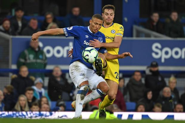 Everton's Brazilian striker Richarlison (left) vies for the ball with Cesar Azpilicueta at Goodison Park.
