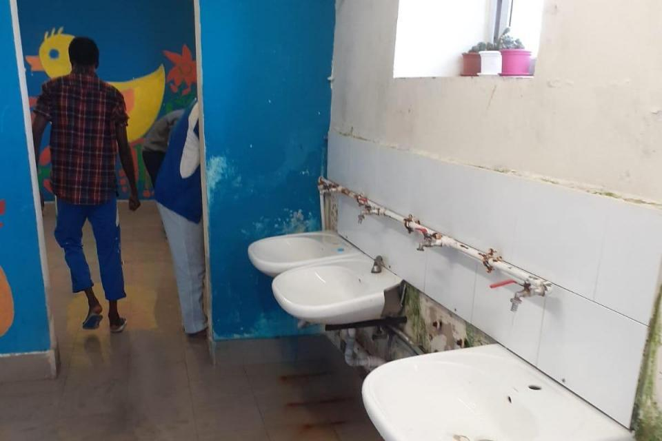 Migrants at Ħal Far are queuing to use bathrooms and are worried about lack of sanitation.
