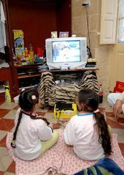 The twins playing on their new PS2 console at the YMCA shelter. Photo: Matthew Mirabelli