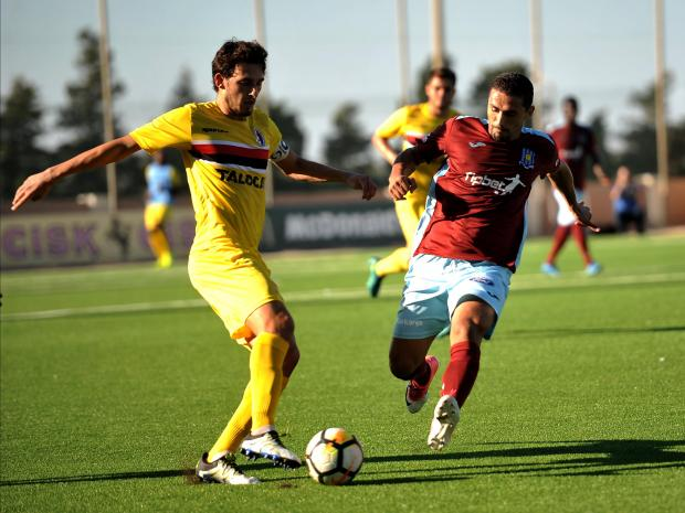 Ħamrun midfielder Triston Caruana is challenged by Roderick Briffa, of Gżira, during a league match this season.