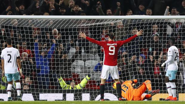Manchester United's Zlatan Ibrahimovic celebrates scoring their fourth goal. Photo: Jason Cairnduff, Reuters