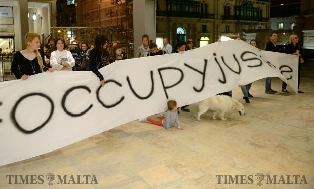 Occupy Justice protestors gather outside the Parliament building in Valletta on October 30 demanding justice following the murder of Daphne Caruana Galizia. Photo: Matthew Mirabelli
