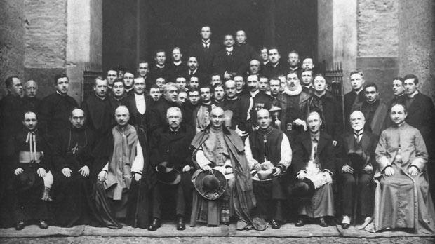 Caruana's consecration as Bishop of Malta on February 10, 1915, feast of St Paul's Shipwreck in Malta, at the basilica of Santa Maria in Trastevere, Rome. Cardinal Merry del Val (centre, front row) is flanked by Caruana (right) and Emanuel Caruana, the bishop's father. Standing, far right, are Fr Michael Gonzi and Fr Enrico Dandria.