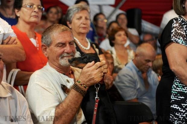 TV personality Salvu Mallia and his pet dog attend a PN political meeting at the Granaries in Floriana on September 17. Photo: Steve Zammit Lupi