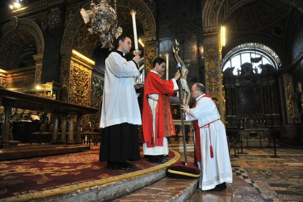 Archbishop Charles Scicluna kisses the Crucifix during a special Good Friday liturgy at St John's Co-Cathedral in Valletta on April 3. Photo: Jason Borg