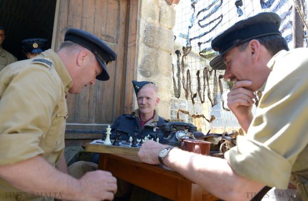 Re-enactors play chess, as Spitfire pilots might have done as they waited to be scrambled during the air battle over Malta during World War II, at a re-enactment at Malta Aviation Museum Foundation in Ta'Qali on May 10. Photo: Matthew Mirabelli