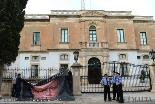 A banner with the Police Commissioners face on is hung on the fencing outside the Police HQ in Floriana on November 5, during the second sit-in protest organised by the Civil Society Network calling for the resignation of the Police Commissioner and the Attorney General. Photo: Matthew Mirabelli