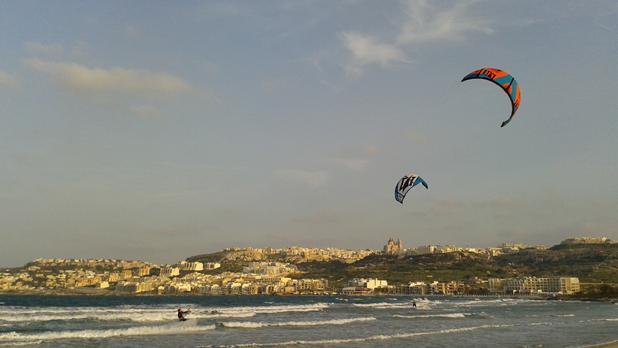 Kite-surfers at Għadira Bay. Photo: Megan Mallia