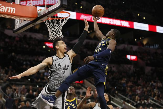 Indiana Pacers point guard Darren Collison (2) shoots the ball as San Antonio Spurs shooting guard Danny Green (14) defends during the second half at AT&T Center. Photo: Soobum Im-USA TODAY Sports