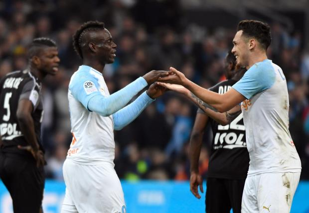Marseille's Mario Balotelli (Left) celebrates his goal against Amiens with Lucas Ocampos.