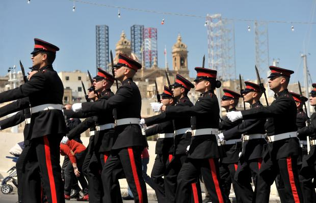 An AFM military parade marches past after a wreath laying ceremony to mark Freedom Day at Vittoriosa on March 31. Photo: Chris Sant Fournier
