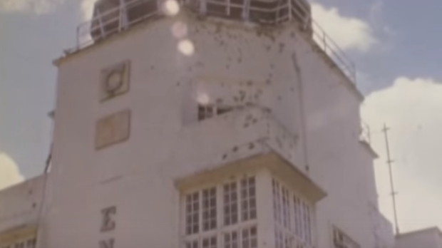 The control tower at Entebbe airport, pot-marked with bullet holes.