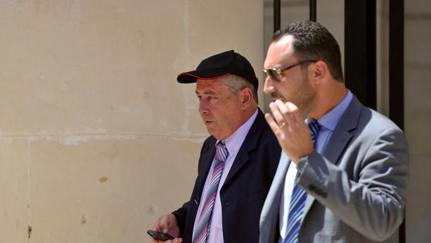 Vincent Muscat (left) exits court some years back.