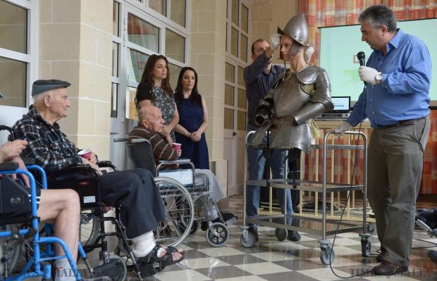 A knight in shining armour is wheeled around St Vincent de Paul Home for the Elderly on May 18. Heritage Malta took museum artifacts to mark the 450th anniversary of the Great Siege of Malta. Photo: Matthew Mirabelli