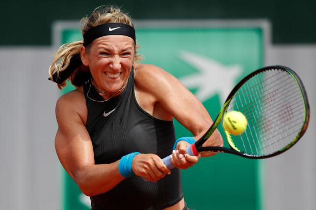 Victoria Azarenka hits a shot at the French Open on Monday.