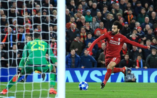 Liverpool's Mohamed Salah scores their first goal.