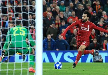 Salah fires Liverpool into Champions League last 16