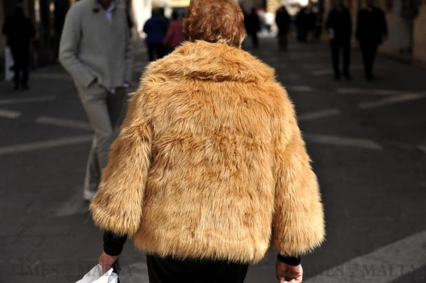 A woman in a fur coat walks down Republic Street in Valletta on March 7. Photo: Chris Sant Fournier