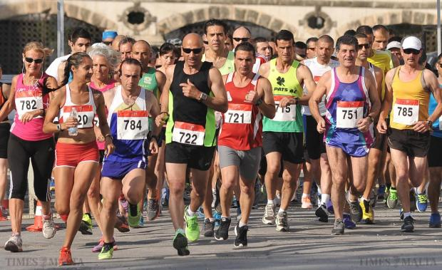 Adults take part in the Olympic Day Fun Run with some opting for the full 10 kilometres that took them from Spinola to Gzira and back on June 15. Photo: Chris Sant Fournier
