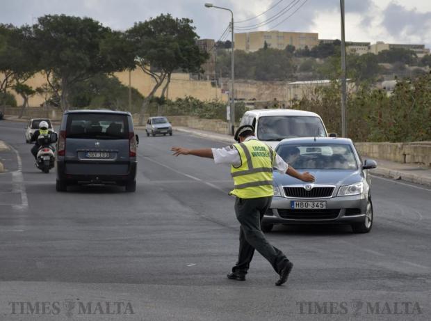 A local warden directs traffic in Naxxar on September 26. Photo: Mark Zammit Cordina