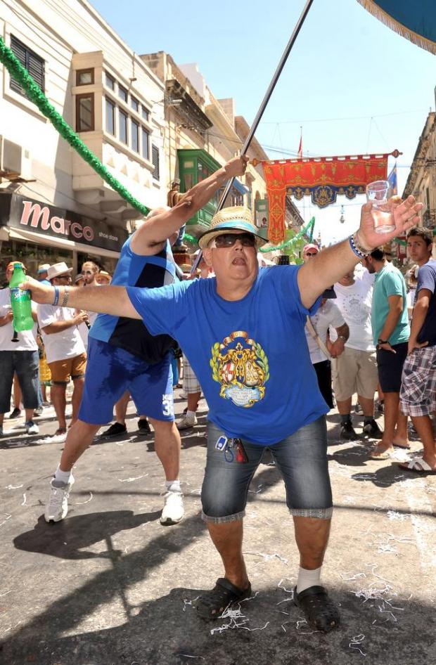 Revellers dance during the march at the Santa Marija feast in Mosta on August 15. Photo: Chris Sant Fournier