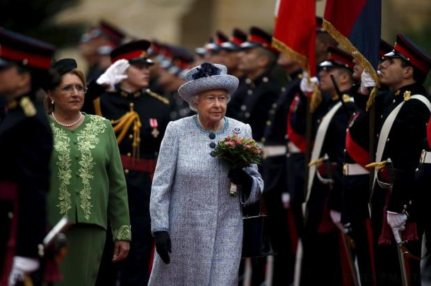 Britain's Queen Elizabeth (centre) and Maltese President Marie-Louise Coleiro Preca inspect a guard of honour at San Anton Palace in Attard after arriving for the Commonwealth Heads of Government Meeting (CHOGM) on November 26. Photo: Darrin Zammit Lupi