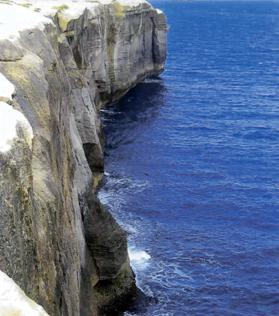 The majestic cliffs and shimmering blue sea in the northwest of Malta.