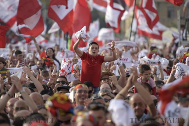 A young boy lifted on shoulders stands out in a crowd during a meeting held by the Labour party in Zabbar on May 7. Photo: Mark Zammit Cordina