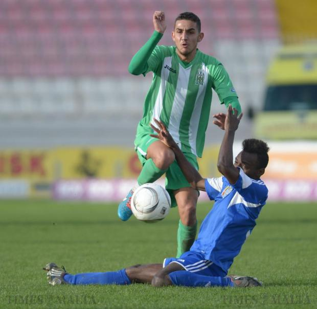 Floriana's Steve Pisani manages to get past Mosta's Ekani Rodriguez during their Premier League match at the National Stadium in Ta'Qali on January 24. Photo: Matthew Mirabelli